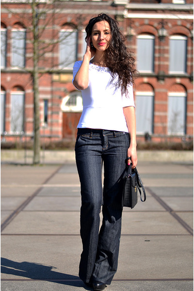 embroidered H&M top - flared Mango jeans
