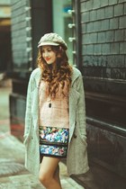 dark green coat - hat - light pink sweater - skirt