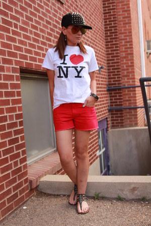 black spiked Amazon hat - white NYC shirt - red denim cutoffs Old Navy shorts
