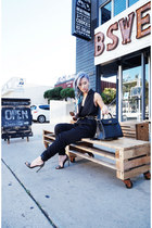 black Hermes bag - black Saint Laurent heels