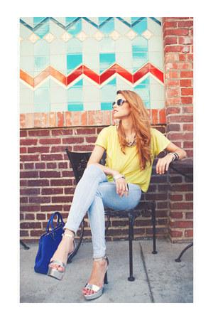 heels - denim leggings - exposed zipper bag - metallic frame sunglasses - top