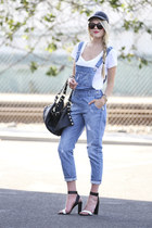 Bold Vitality: Distressed Overalls, Leather Cap, &amp; Red Lips