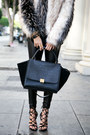 Ivory-faux-fur-haute-rebellious-jacket-black-celine-bag