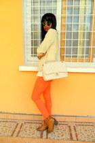 tawny santiag boots - eggshell jacket - cream bag - carrot orange Skinny pants