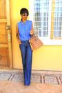 Blue-denim-flared-jeans-denim-studded-collar-shirt-mustard-bag
