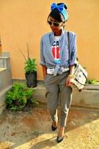 black Christian Louboutin heels - beige Time bag - Ray Ban sunglasses