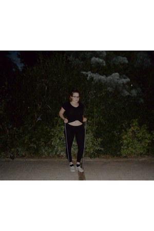 black leggings - black shirt - black H&M socks - dark khaki Vans sneakers