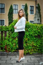 white jacket - black dress - gold accessories - white heels
