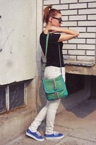 black sunglasses - green bag - black t-shirt - beige pants - blue Vans sneakers