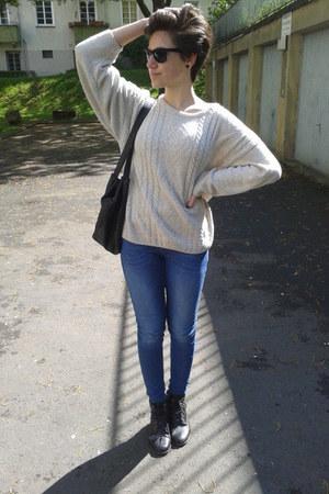 black glasses - blackleather boots - blue jeans - beige sweater