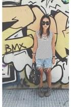 black balenciaga bag - blue Levis shorts - black Celine sunglasses