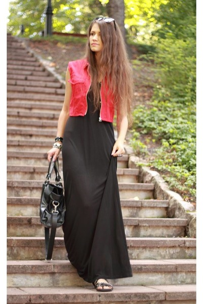 red vest - black dress - black bag
