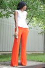 Light-orange-bag-beige-heels-white-blouse-orange-pants