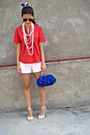 Red-shirt-blue-bag-white-shorts