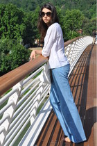 dark brown flared Chloe jeans - sky blue vintage shirt - white Prada sunglasses