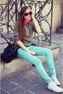 Light-brown-shirt-off-white-converse-sneakers-aquamarine-sandro-pants