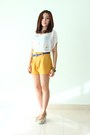 Mustard-shorts-navy-leather-belt-ivory-sheer-top-off-white-wedges