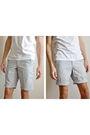 White-uni-qlo-shirt-blue-uni-qlo-shorts-beige-clarks-boots