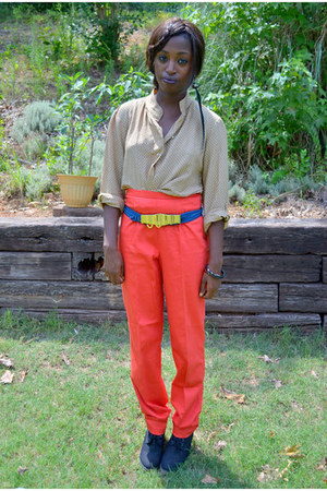 black boots - gold belt - carrot orange pants - blue belt - tan Chanel blouse -