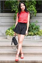 red polka dots Larmoni top - black pleated Larmoni shorts