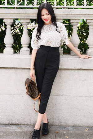 white crochet Larmoni top - black belted Larmoni pants