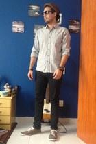 brown Marc Ecko hat - black Levis jeans - light blue pull&bear shirt