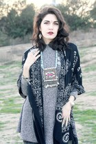 black ankle Frye boots - grey knit dress - printed leggings