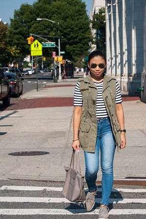 navy jeans - white top - olive green vest