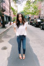 blue high rise Levis jeans - white The Kooples blouse - Misha Nicole necklace