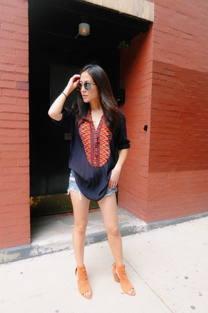 blue Paige Denim shorts - navy SANDRO top - tawny Emu Australia sandals