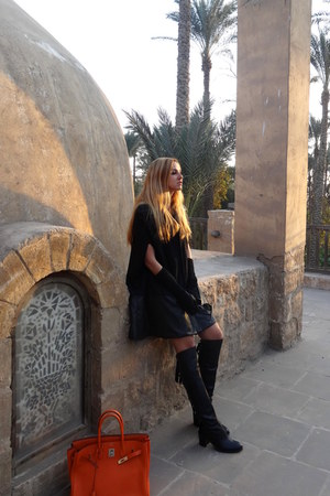 black Aya Afify cape - black Nour Aboulela boots - carrot orange Hermes bag