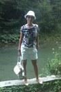 White-new-yorker-hat-light-brown-sisley-bag-white-sprider-shorts
