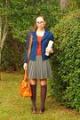 Blue-jacket-orange-shirt-gray-skirt-brown-socks-brown-shoes-orange-bag