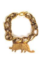 Brass-dinosaur-manic-trout-bracelet