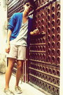 Beige-shorts-gold-shoes-gray-shirt-blue-cardigan-gold-accessories