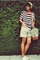 white shirt - beige shorts - yellow hat - white shoes - gray purse - black glass