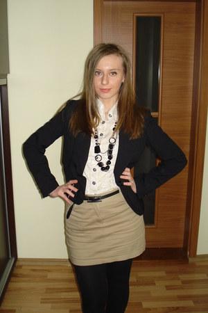 black jacket - black leggings - off white shirt - tan skirt