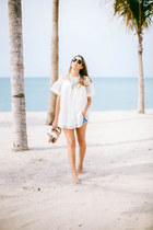 silver statement Nueve musas necklace - sky blue ripped Billabong shorts