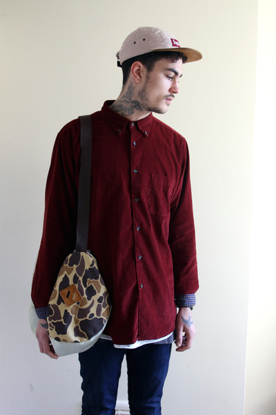 uni-qlo shirt - Supreme hat - Enclave bag
