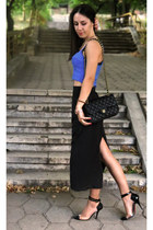 blue cut out top - black classic Chanel bag - black long skirt
