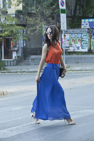blue pleated skirt skirt - black classic Chanel bag - orange H&M top