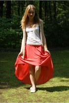 white shoes - red shirt - bronze bag - tan vest - white t-shirt