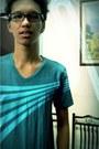 Turquoise-blue-shirt-black-glasses
