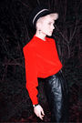 Red-shirt-black-pants-black-hat-silver-accessories