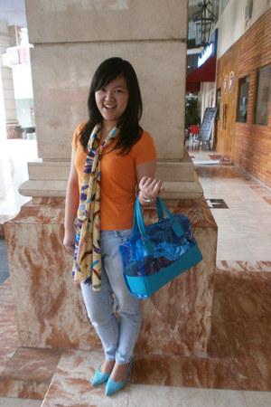 orange Its A Store top - light blue shoes - light blue jeans - neutral scarf