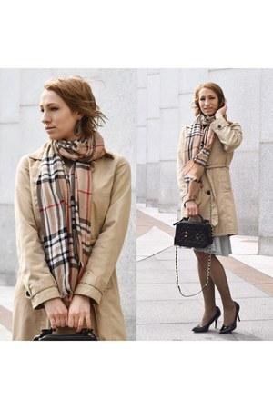 camel coat - black Chanel bag
