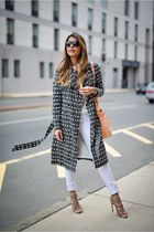 black printed Reiss coat - white white Reiss jeans - white v-neck Reiss sweater