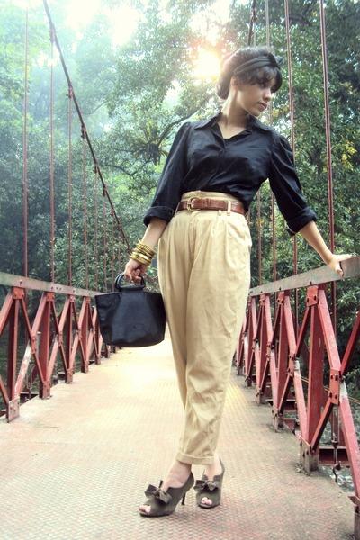 black top - beige pants