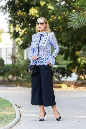 sky blue Self Portrait blouse - maroon Tibi pants