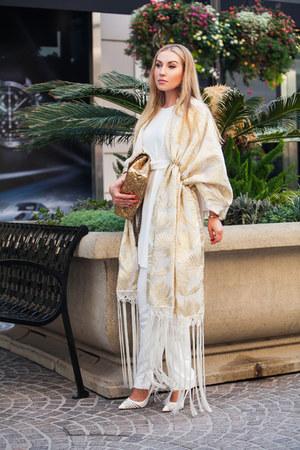 gold DelPozo cape - ivory Christian Louboutin pumps